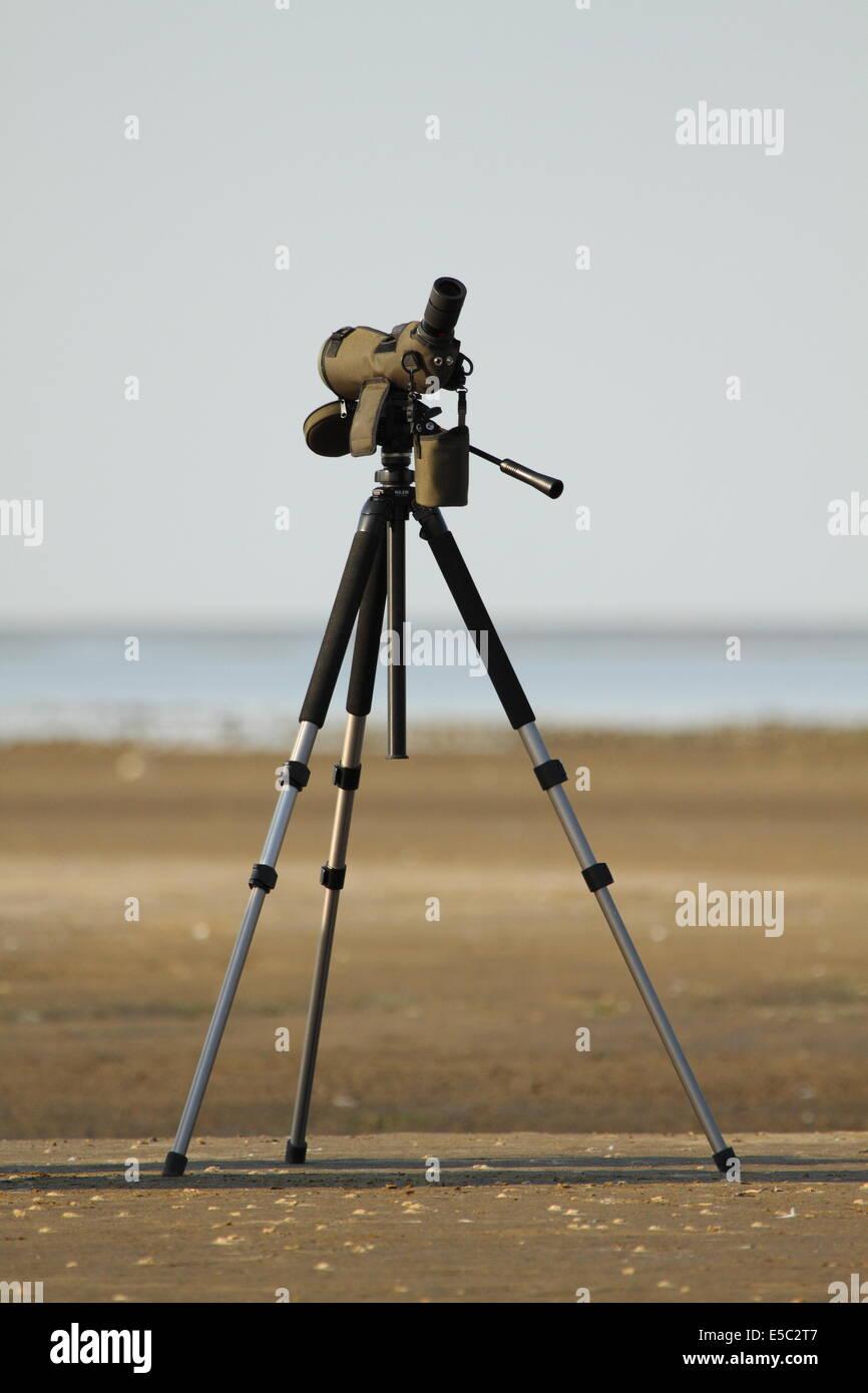 Spotting telescope and tripod on a beach for birding - Texas, USA - Stock Image