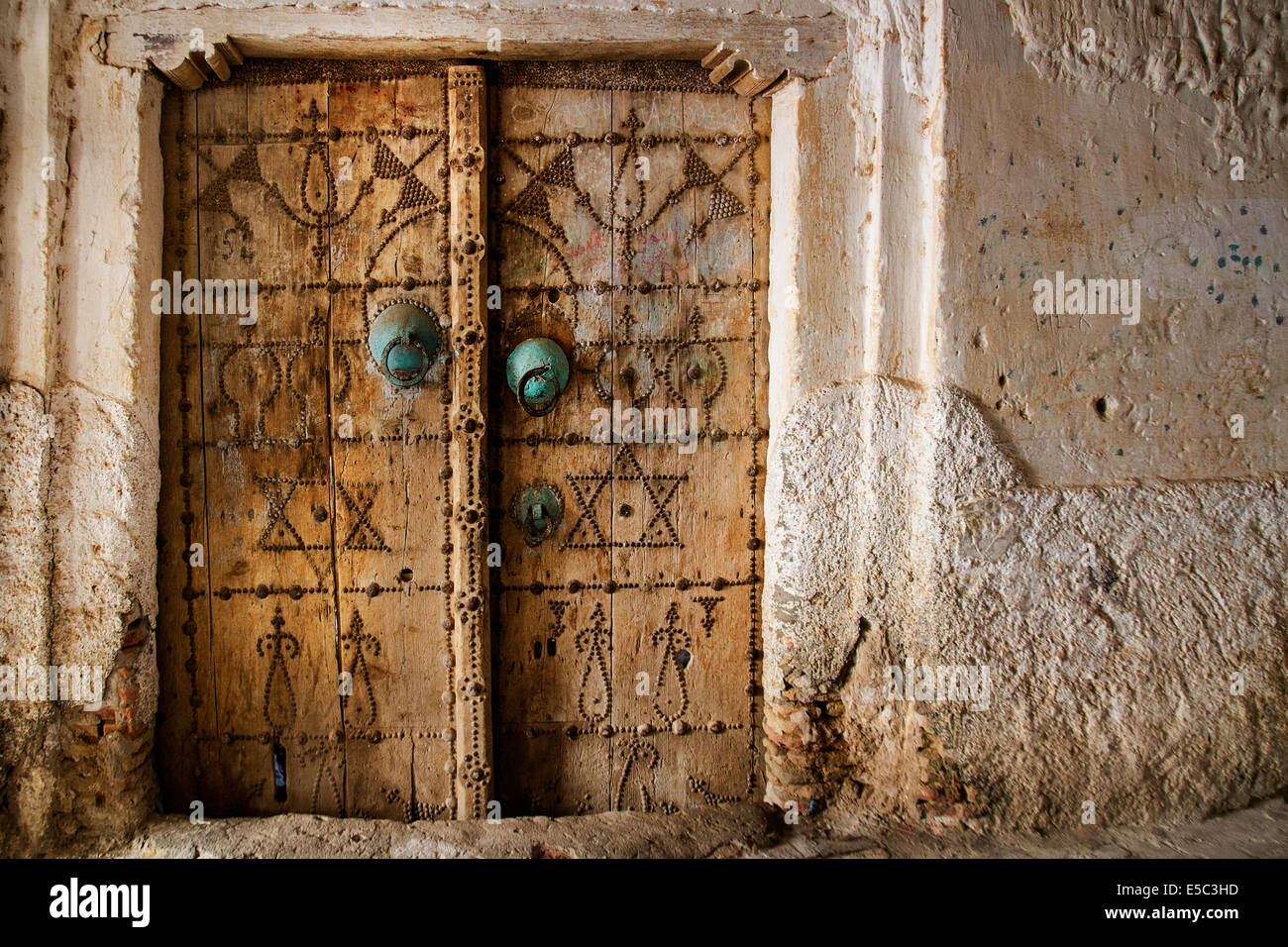Traditional door (knobs) in the old town of Nefta (Medina) an oasis in the Saharan desert. & Traditional door (knobs) in the old town of Nefta (Medina) an oasis ...