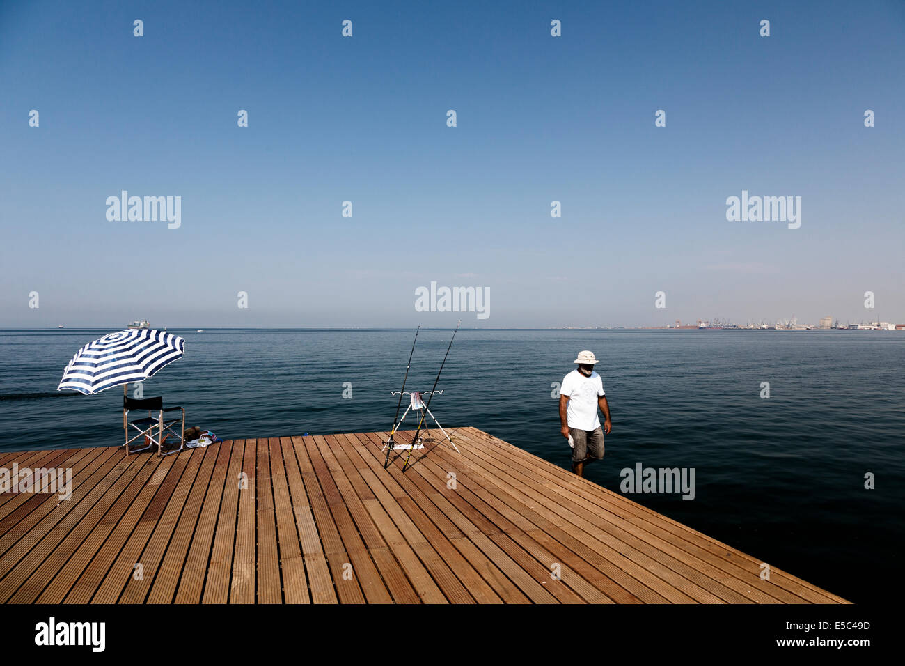 A fisher at the seafront of Thessaloniki, Greece. - Stock Image