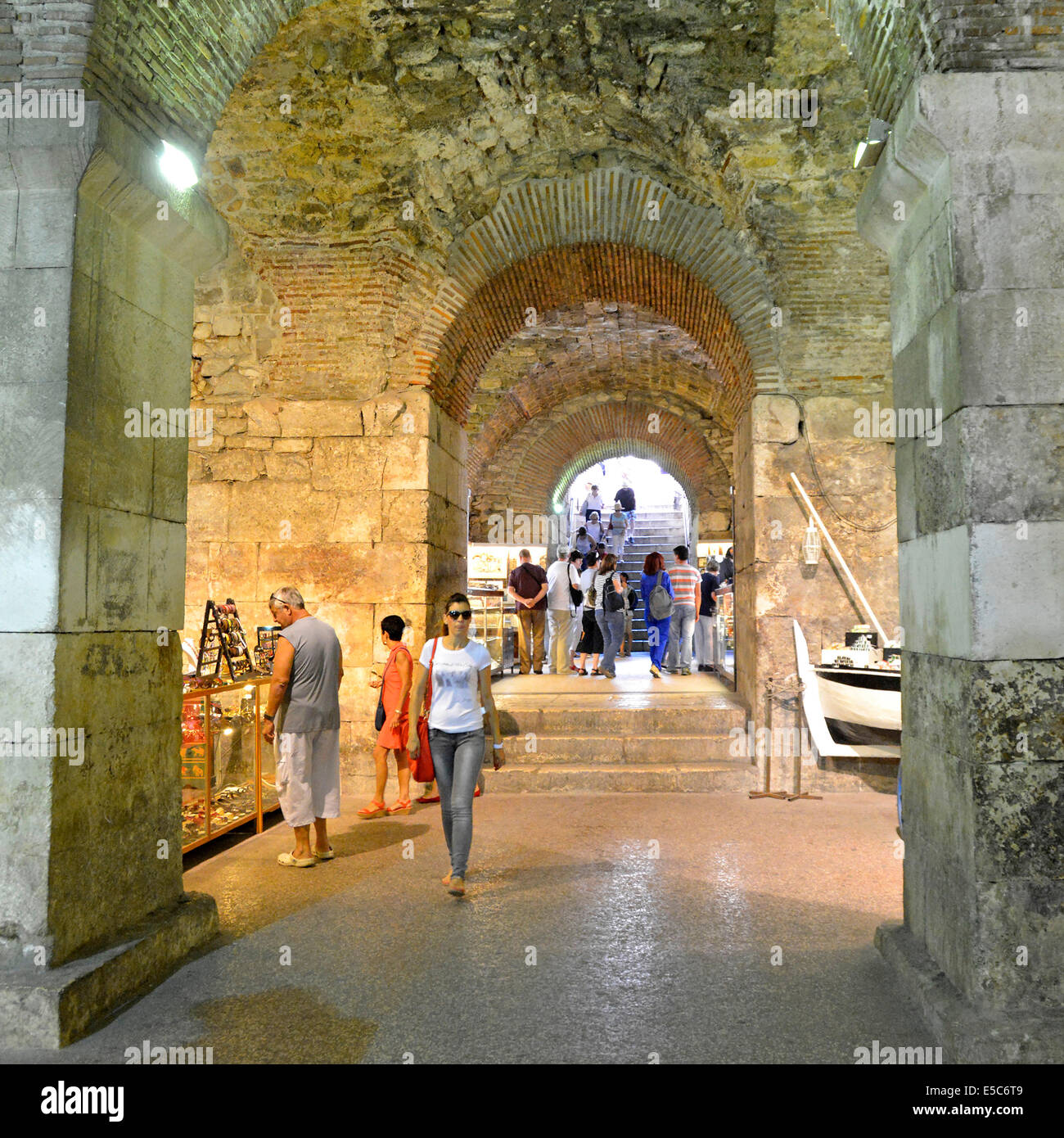 Tourists in the enclosed passageway linking Split waterfront with the Diocletians Palace and now lined with souvenir - Stock Image