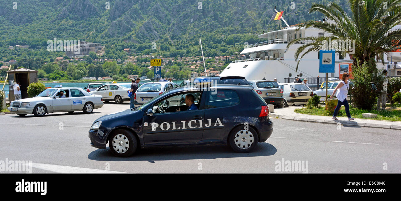Policija car patrolling the cruise ship arrival area of Kotor harbour - Stock Image