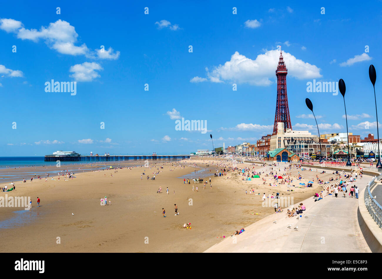View from Central Pier towards North Pier and Blackpool Tower, The Golden Mile, Blackpool, Lancashire, UK - Stock Image