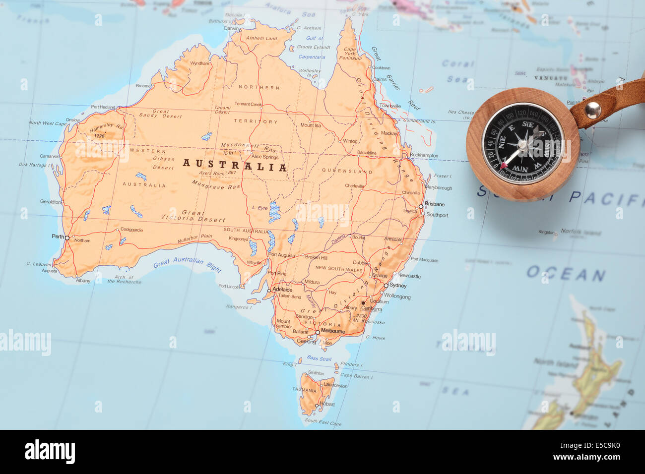 Compass on a map pointing at Australia and planning a travel Stock