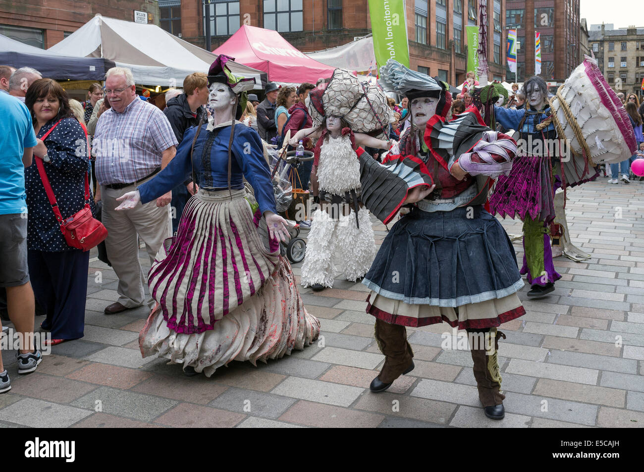 Street entertainers performing at the Merchant City festival during the Commonwealth Games, Glasgow, Scotland, UK - Stock Image