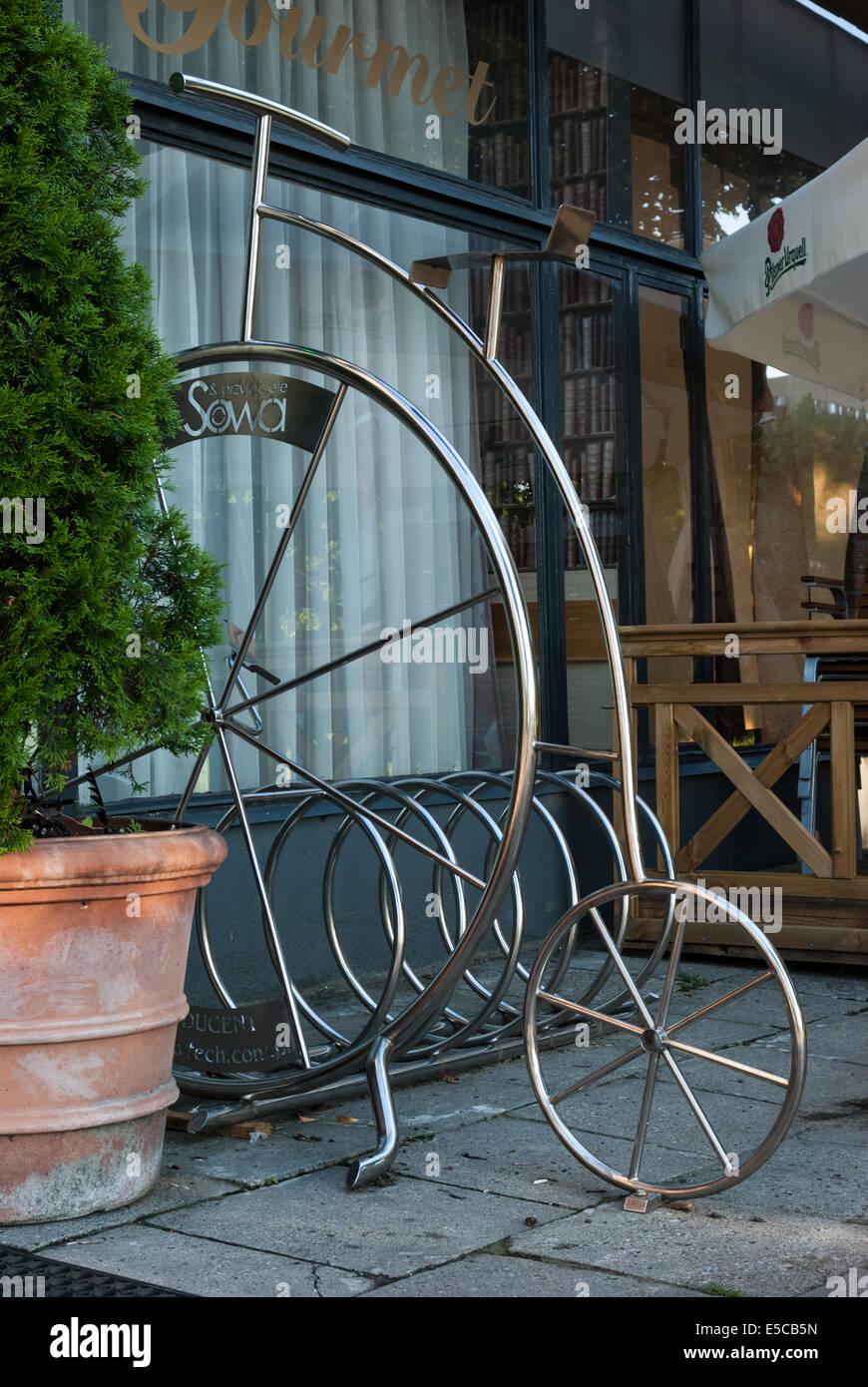 Fancy Bicycle Rack at Restauracja Sowa i Przyjaciele  (Owl and Friends Restaurant), Warsaw, Poland - Stock Image