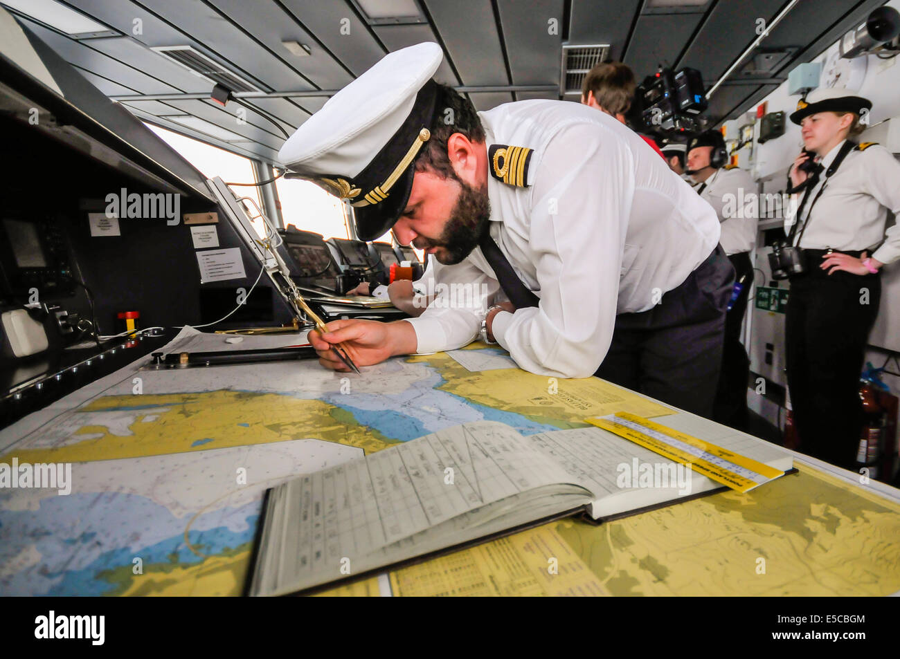 Belfast, Northern Ireland. 26/07/2014 - Navigation officer checks course as the newest ship in the Royal Navy, the - Stock Image