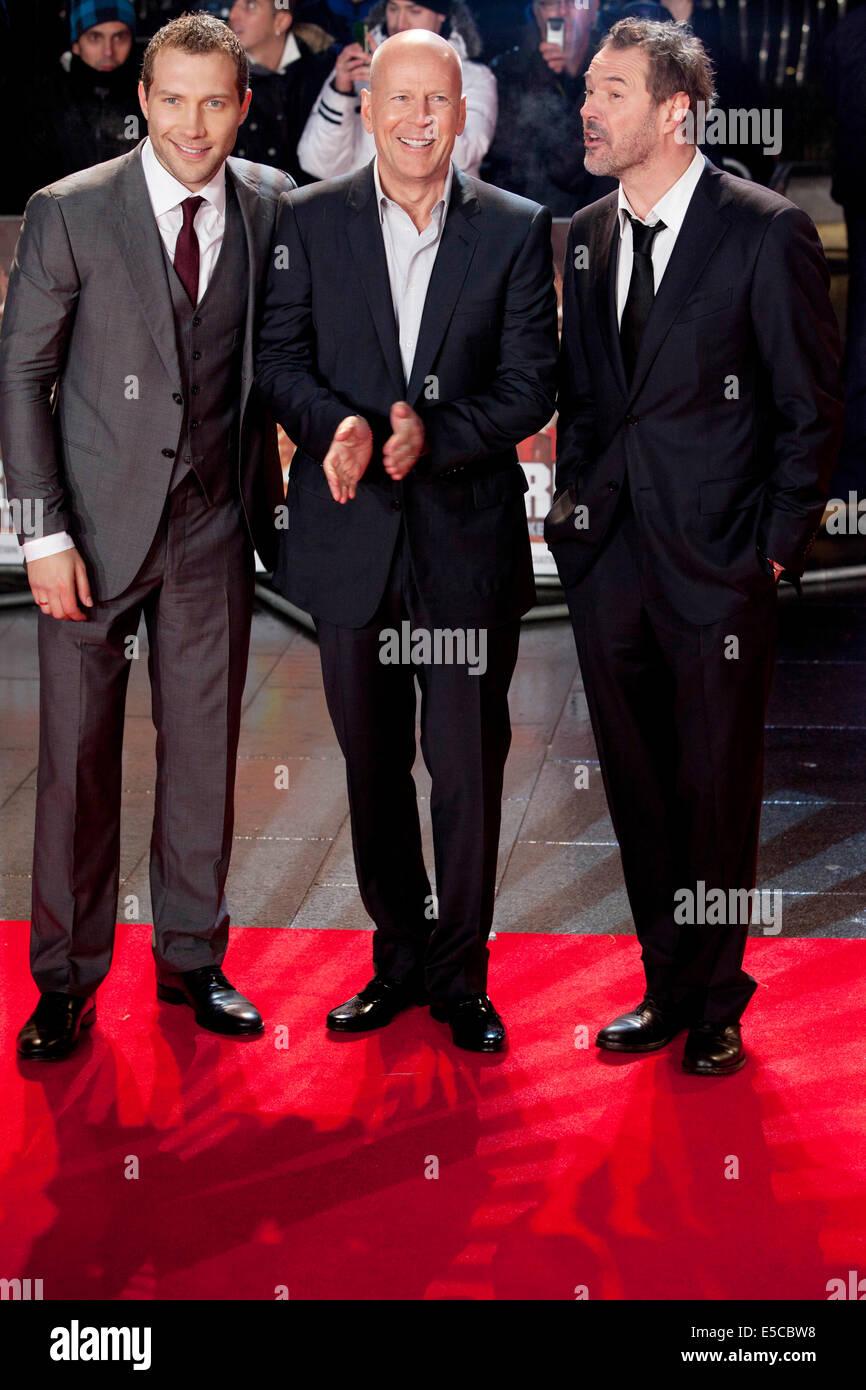 JAI COURTNEY Bruce Willis SEBASTIAN KOCH ,Die Hard UK film premiere - Stock Image