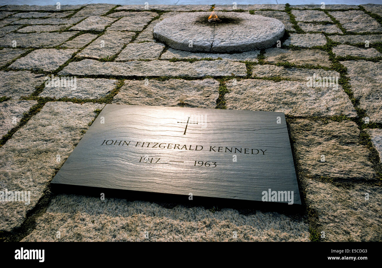 An eternal flame burns at the grave of 35th U.S. President John Fitzgerald Kennedy in Arlington National Cemetery - Stock Image