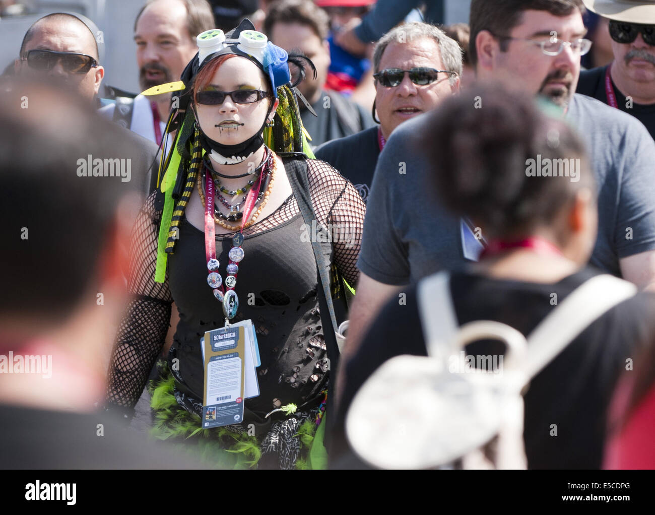 San Diego, California, USA. 26th July, 2014. A young post apocalyptic space girl crosses the street in a crowd. - Stock Image
