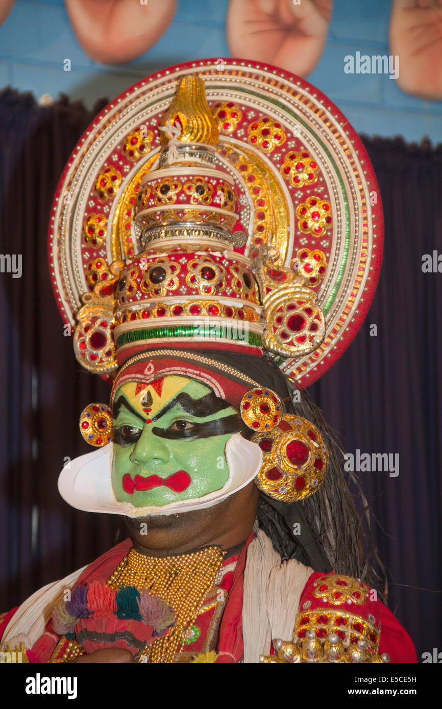 Actor in Kathakali, Kerala's classical dance-drama, wears heavy makeup (green face shows hero) as well as elaborate - Stock Image