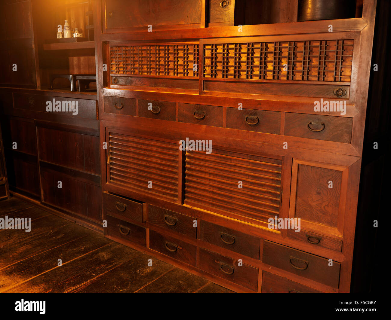 Antique wooden furniture in a historic Japanese house at Gero Onsen Gassho Village, Gifu Prefecture, Japan 2014 - Stock Image