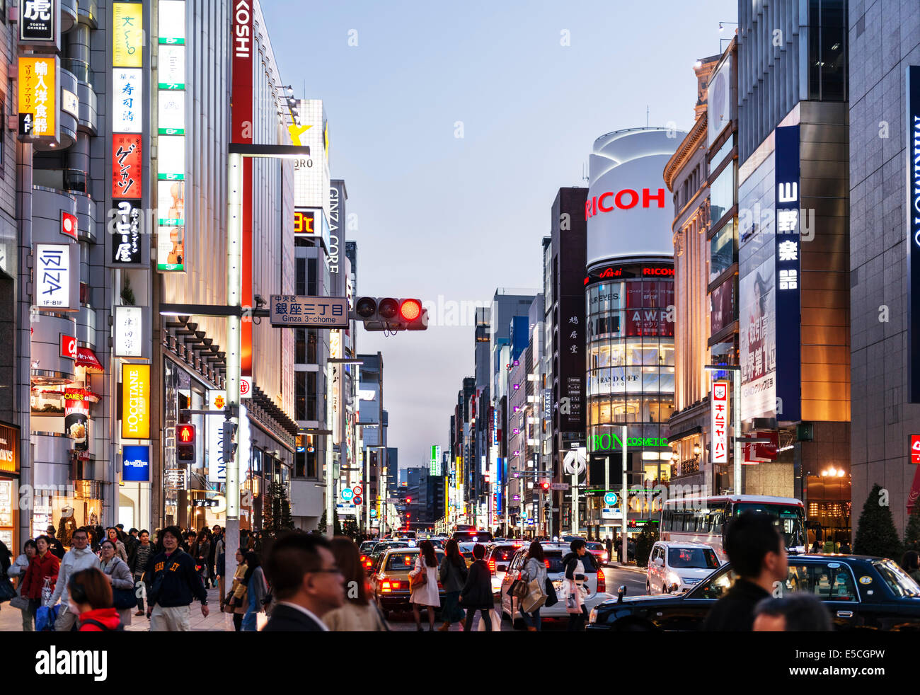 Tokyo city streets filled with people and cars at dusk. Ginza, Tokyo, Japan 2014 Stock Photo