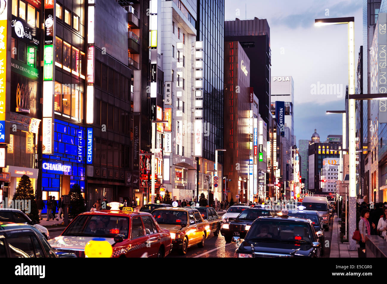 Tokyo city streets filled with taxi cabs at dusk. Ginza, Tokyo, Japan 2014 - Stock Image