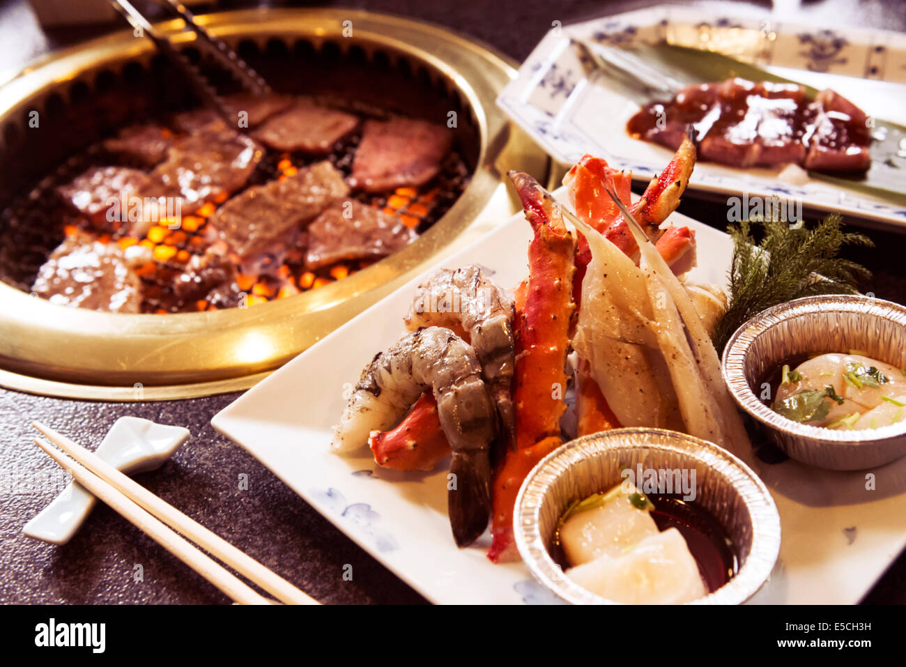 Beef And Seafood Being Cooked At A Japanese Grill Restaurant Stock Photo Alamy
