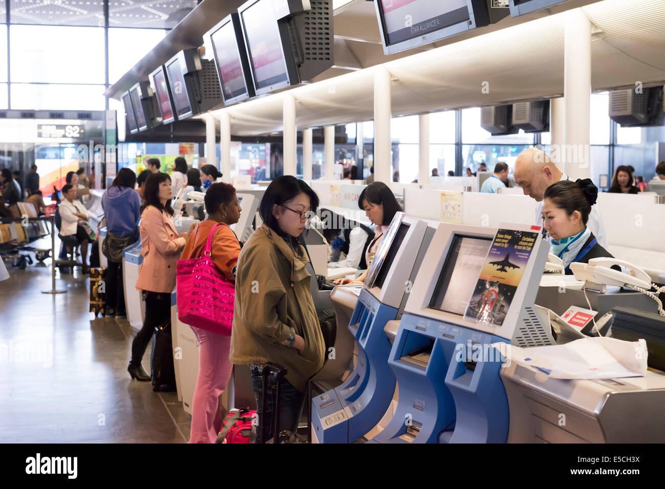 People at Air Canada check-in counter of Narita International Airport in Japan - Stock Image