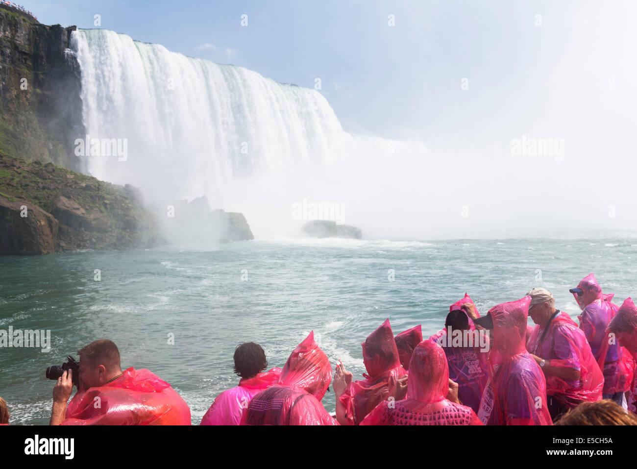 Niagara Falls boat ride. Hornblower Niagara Cruises, Ontario, Canada 2014. - Stock Image