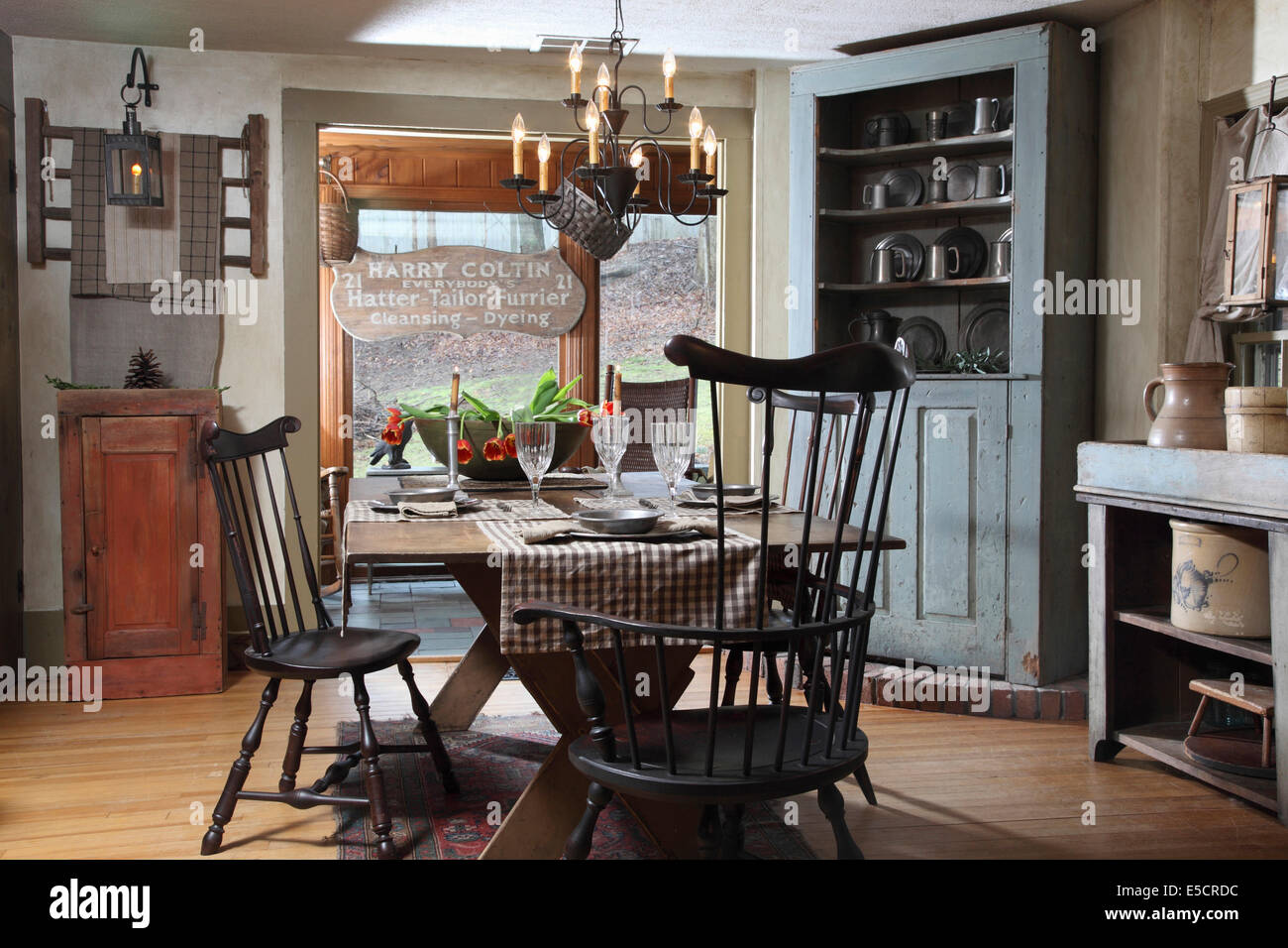 Rustic Style Dining Room With Corner Cabinet And Pewter Items, USA.