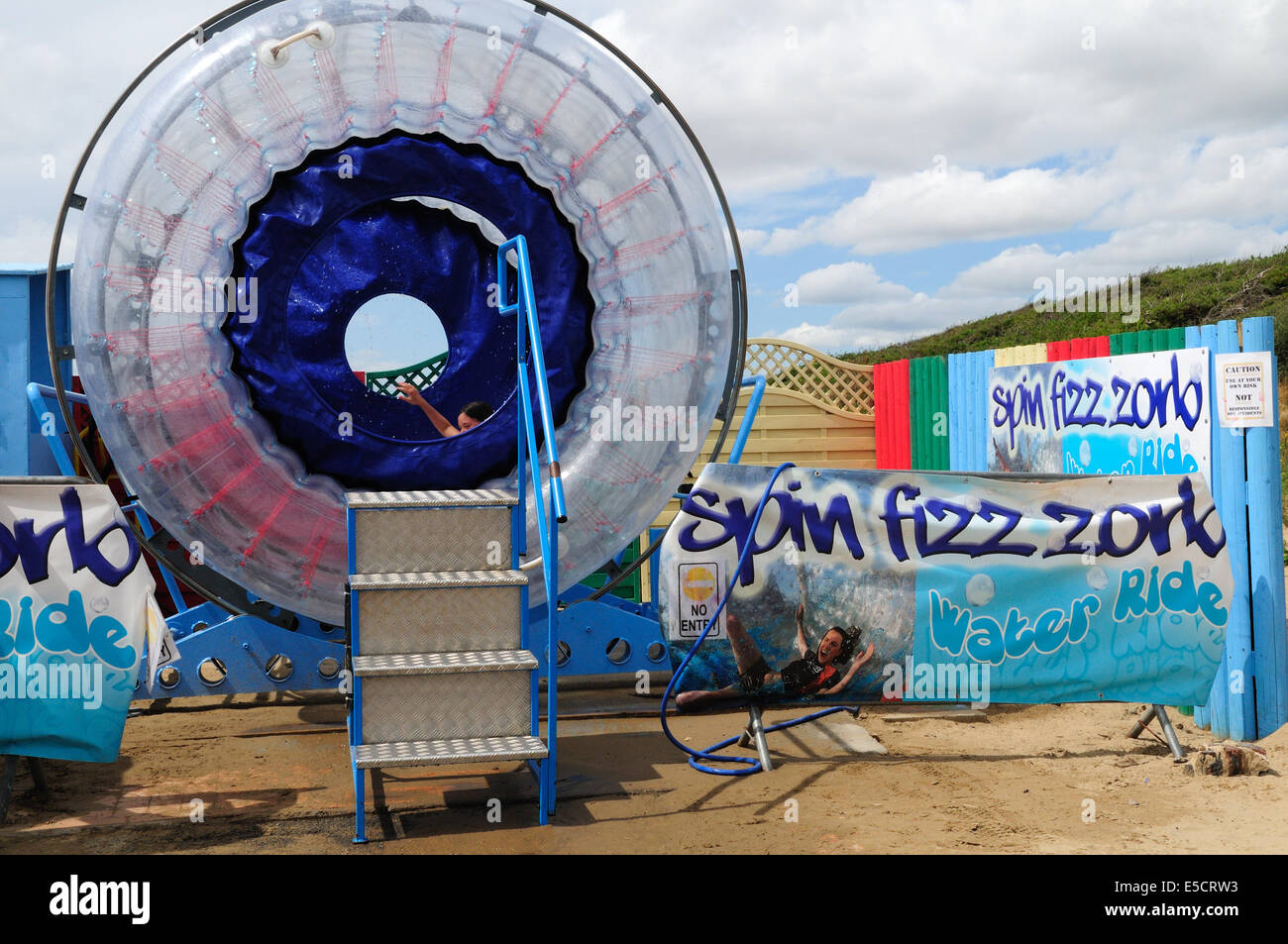 Spin fizz zorb  water ride Pembrey Country Park Carmarthenshire - Stock Image