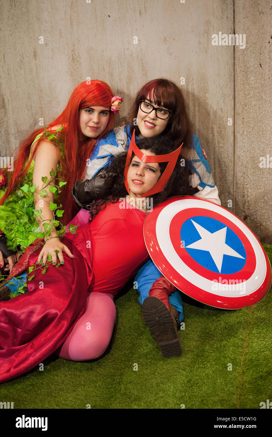 Girls dressed as superheroes or superheroines posing at Comic Con on May 17, 2014 in Barcelona, Catalonia, Spain. - Stock Image