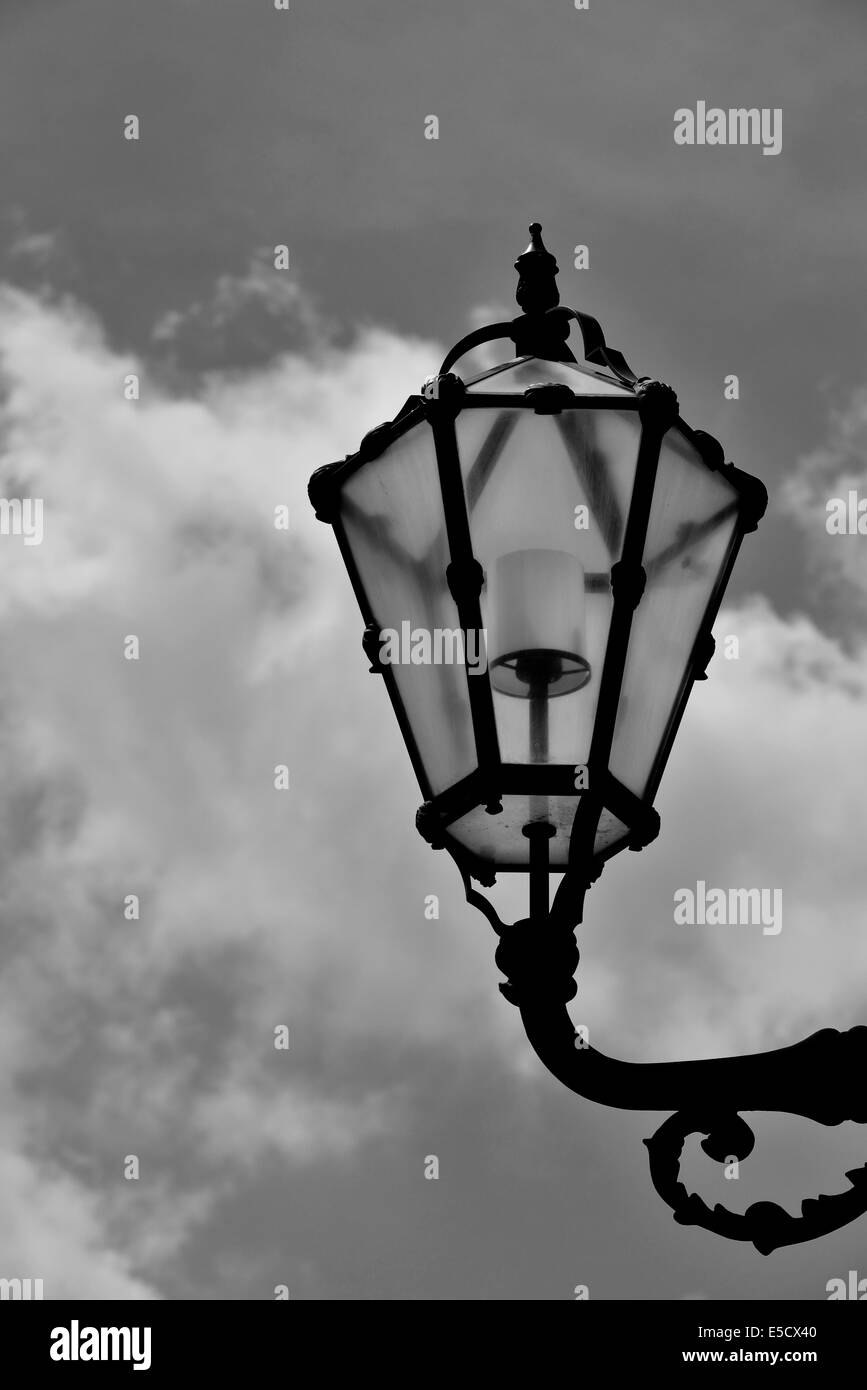 Street lamp against the cloudy sky - Stock Image