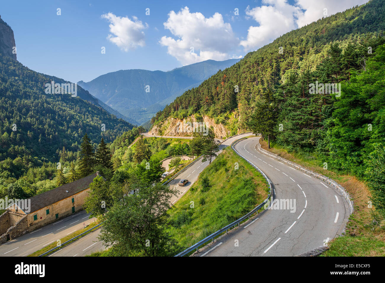 Narrow alpine highway on French-Italian border in Alps, France (view from above). Stock Photo