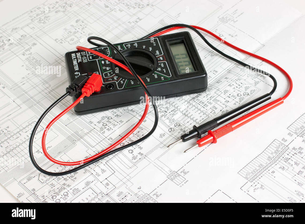 multimeter on the background of electronic circuits - Stock Image