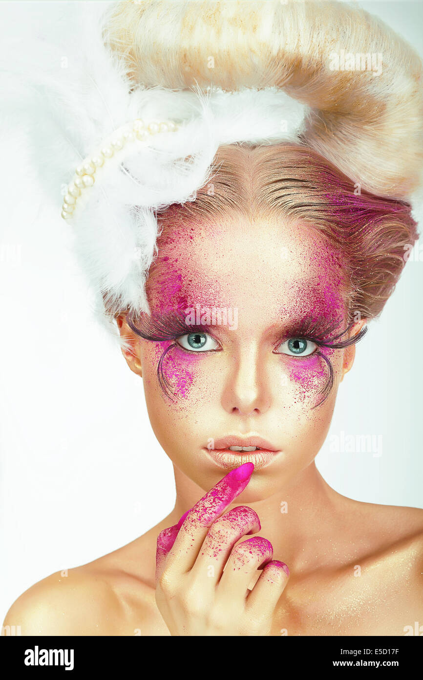 Visage. Styled Woman with Painted Smeared Skin and Fingers Stock Photo
