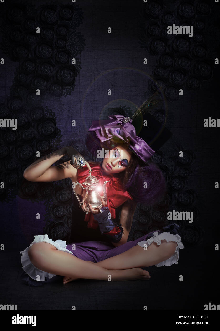 Witchcraft. Fairytale. Enigmatic Magus with Lamp in Darkness - Stock Image