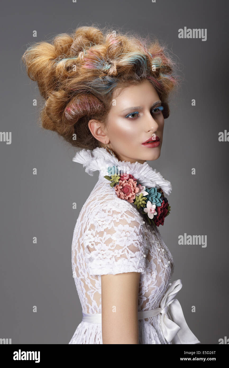Updo. Dyed Hair. Woman with Modern Hairstyle. High Fashion Stock Photo