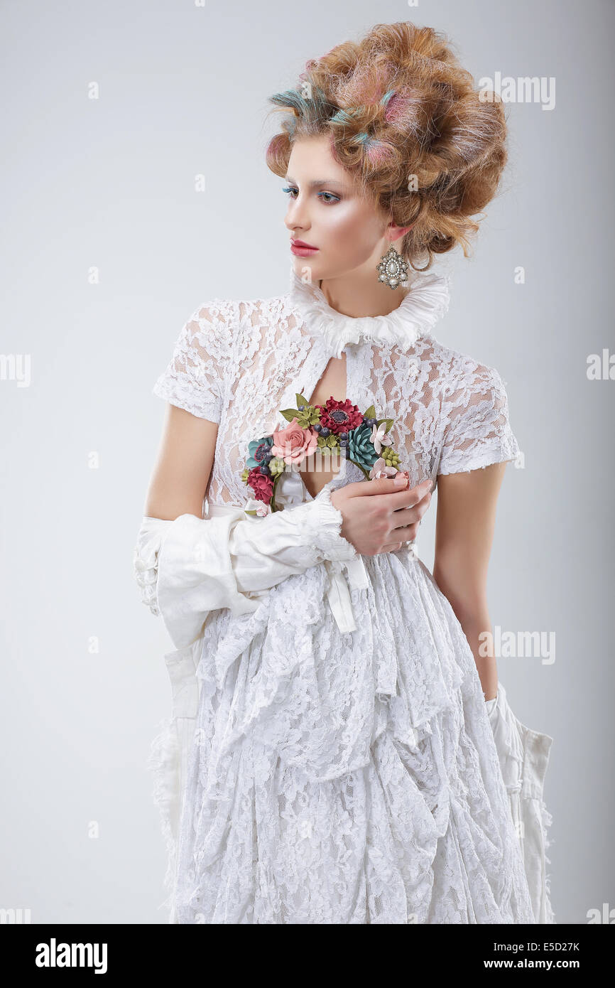 Fashion Model in Flossy White Dress and Wreath of Flowers Stock Photo