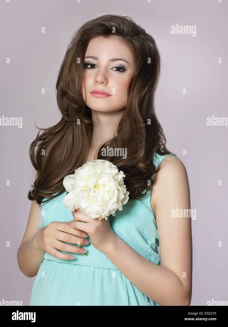 Nostalgia. Young Adorable Teen Girl with Peony Flower - Stock Image