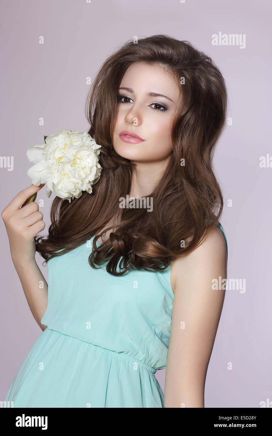 Sincere Gentle Meek Woman with Peony Flower - Stock Image