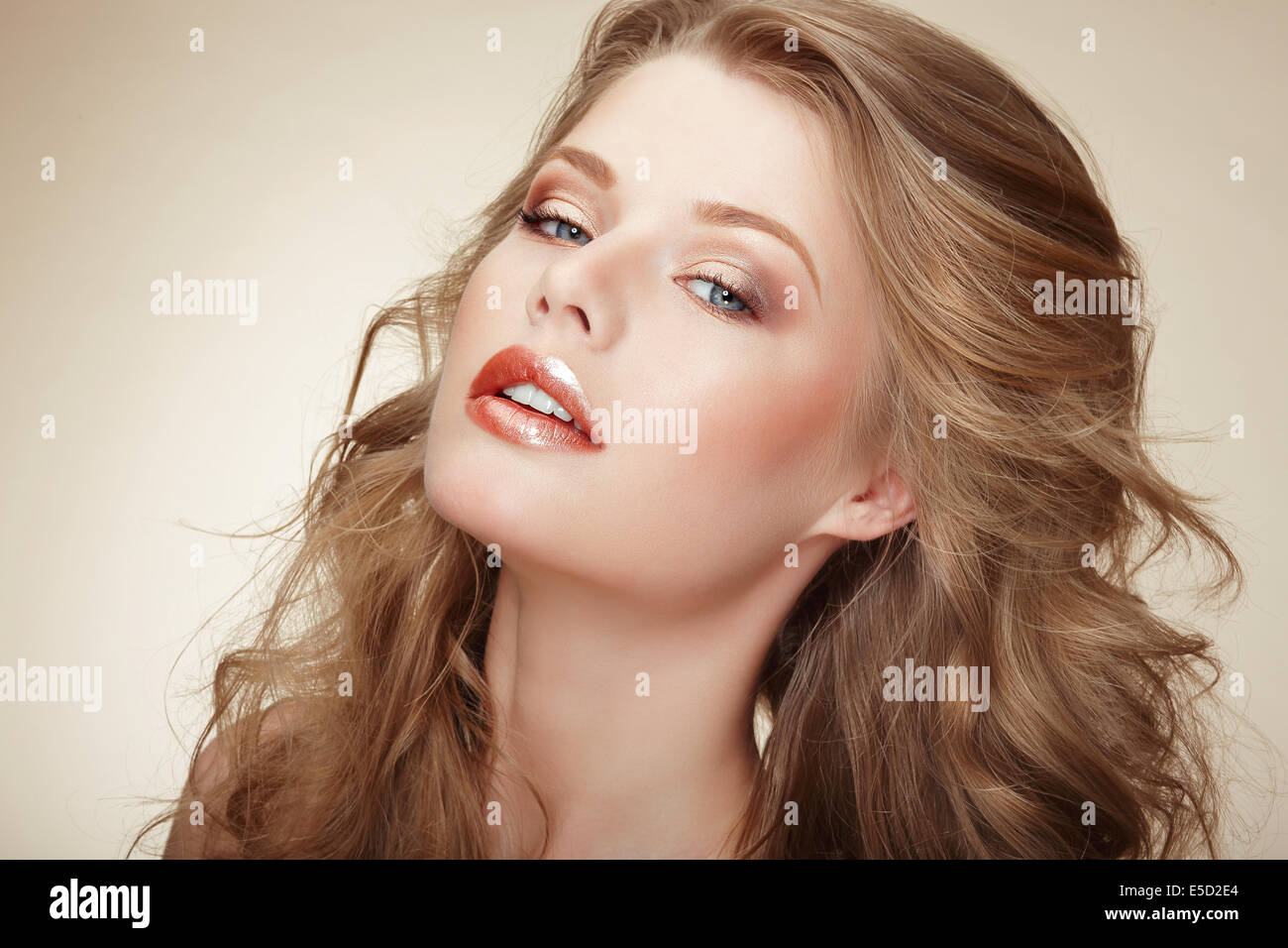 Genuine Comely Woman with Flossy Whity-Brown Hair - Stock Image