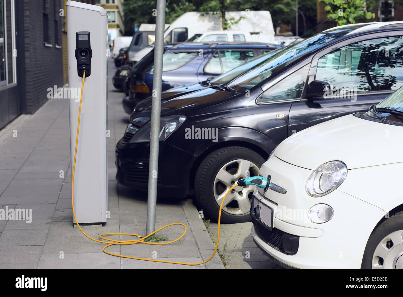 Recharge. Electric Car in Free Charging Station. Environmentally Friendly Transport - Stock Image