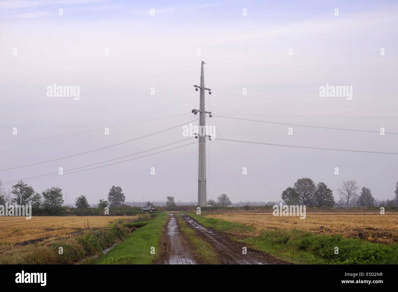 Italy, reconstruction of an high-voltage power line with low environmental and scenic impact pylons - Stock Image