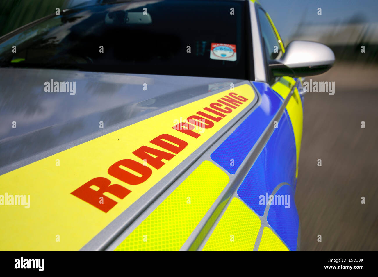 Lisburn, Northern Ireland. 25 Jul 2014 - 'Road Policing' on the bonnet of a traffic unit police patrol vehicle - Stock Image