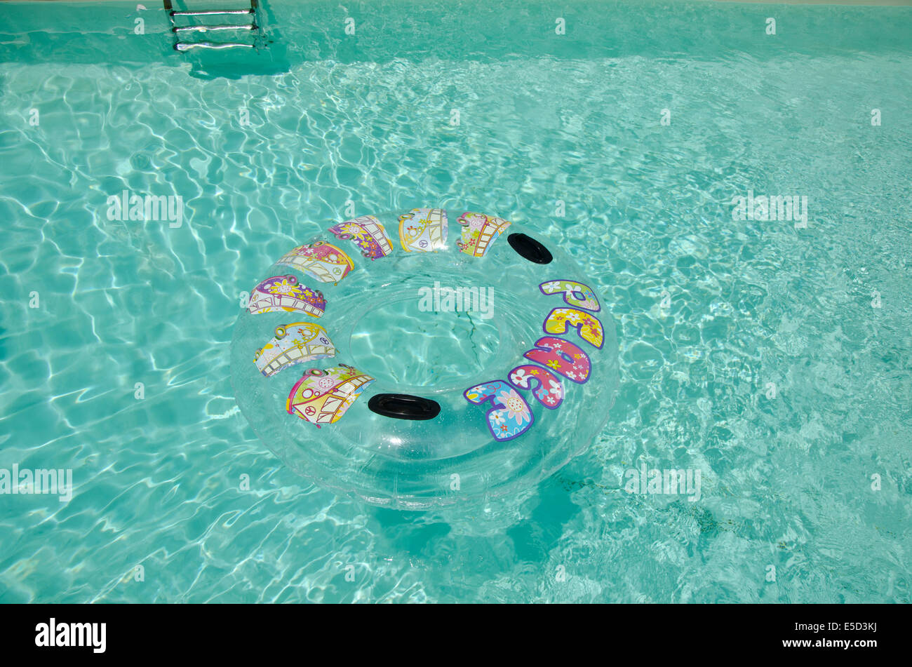 River tube in swimming pool with peace written on it Stock ...
