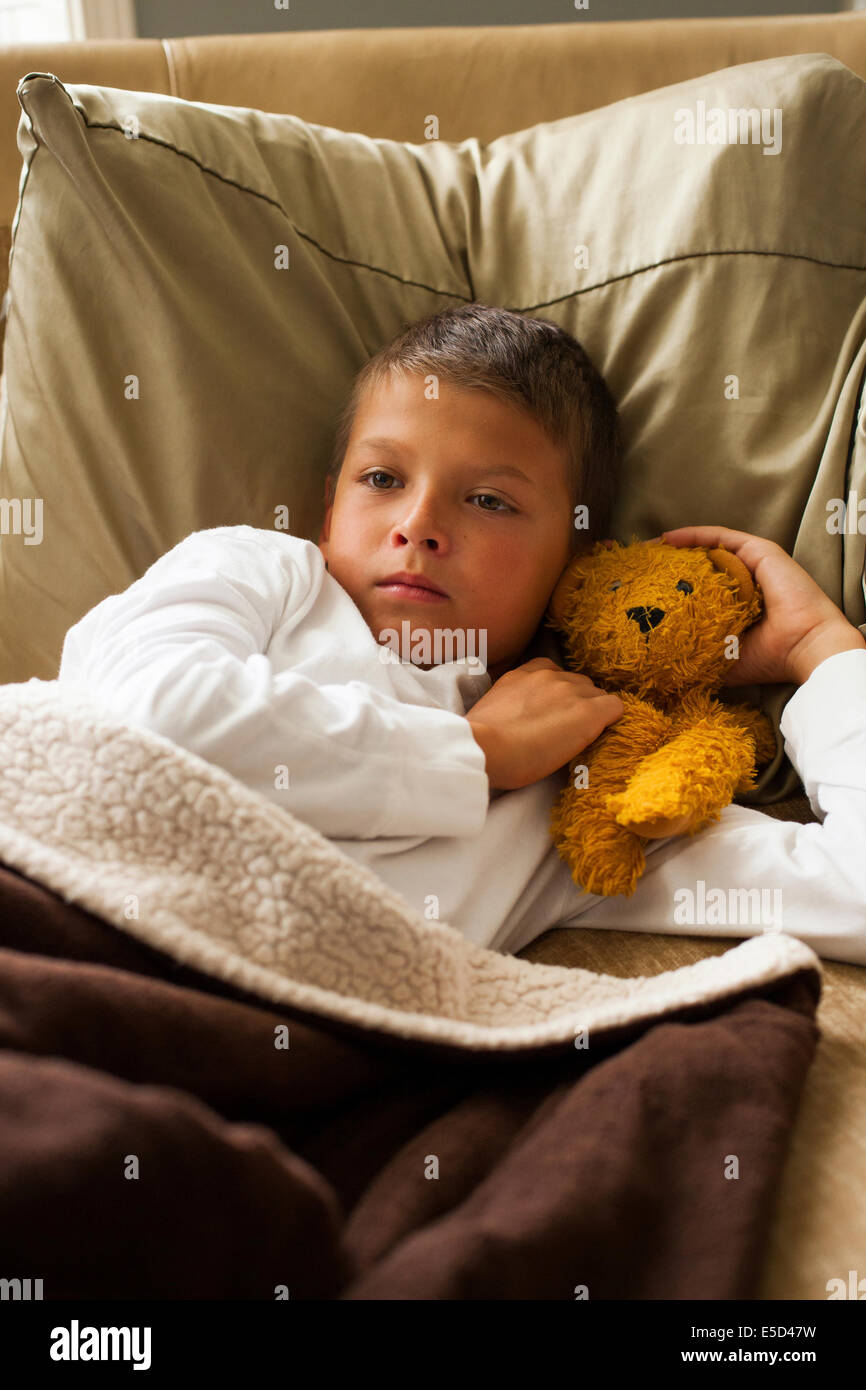 child feeling sick in bed Stock Photo
