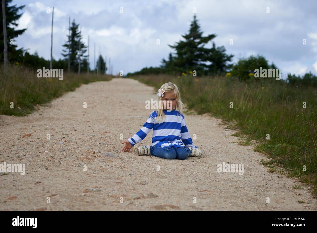 Child blond girl tourist exploring the Giant mountains, Krkonose, Czech Republic - Stock Image