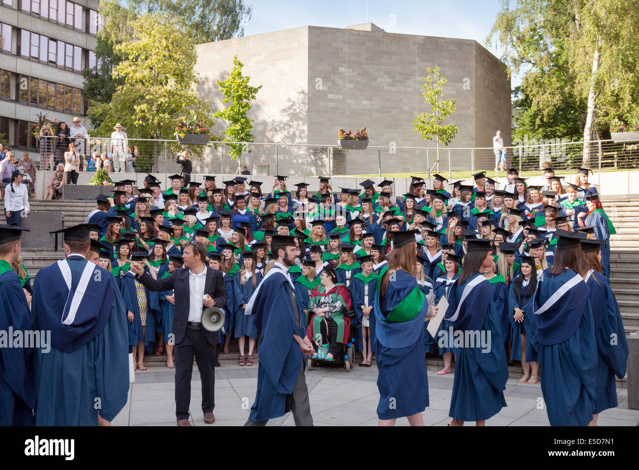 Graduates preparing for a group photograph at UEA ( University of East Anglia ), Norwich England UK - Stock Image