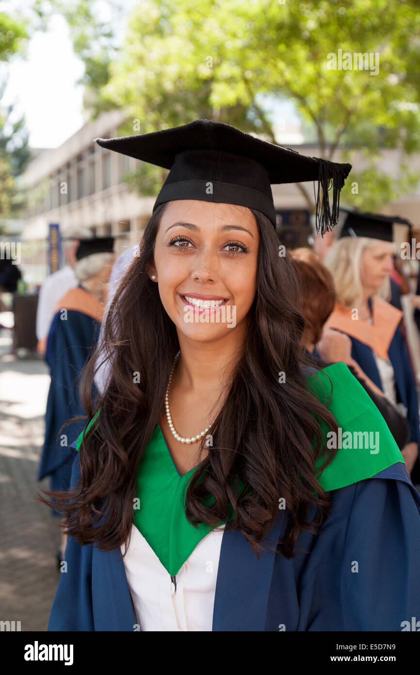 Young woman graduate graduating on graduation day, in gown and mortar board, UEA ( University of East Anglia ), - Stock Image