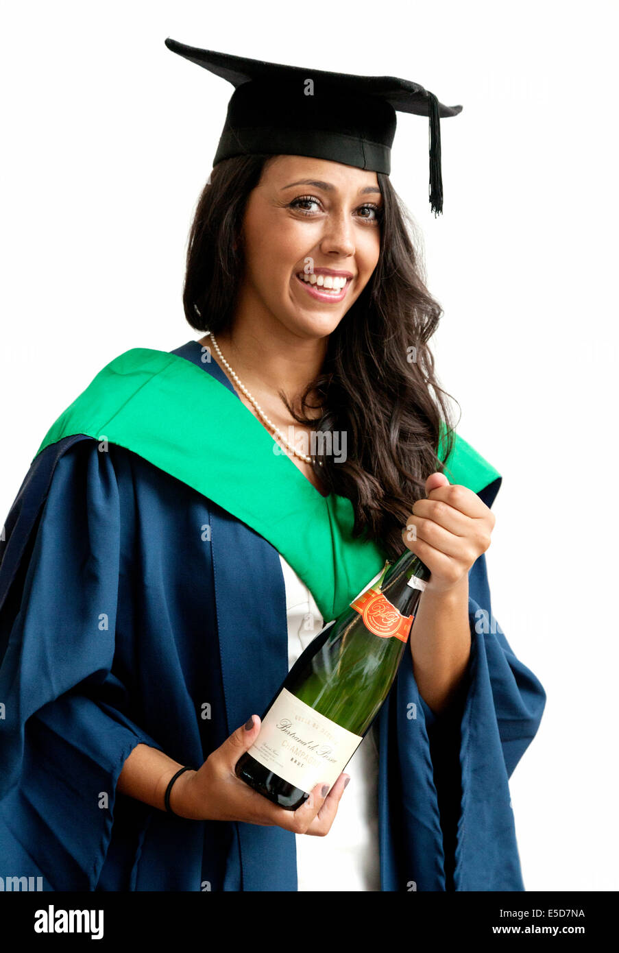 A woman graduate on her graduation day smiling and holding a bottle of champagne, UEA ( University of East Anglia - Stock Image
