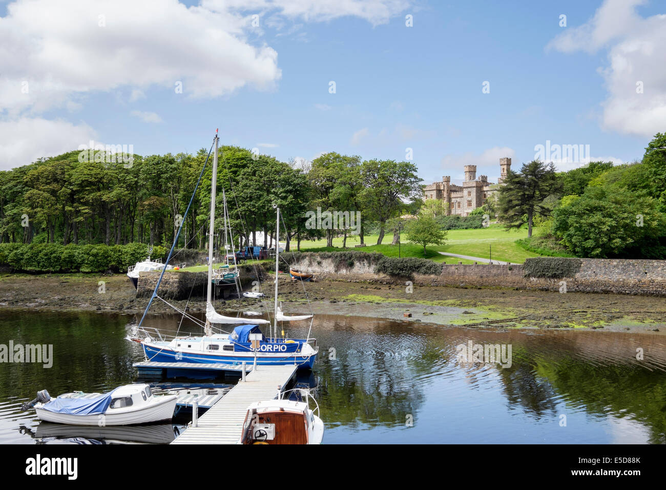 Lews castle from across harbour with moored boats in Stornoway Isle of Lewis Outer Hebrides Western Isles Scotland - Stock Image