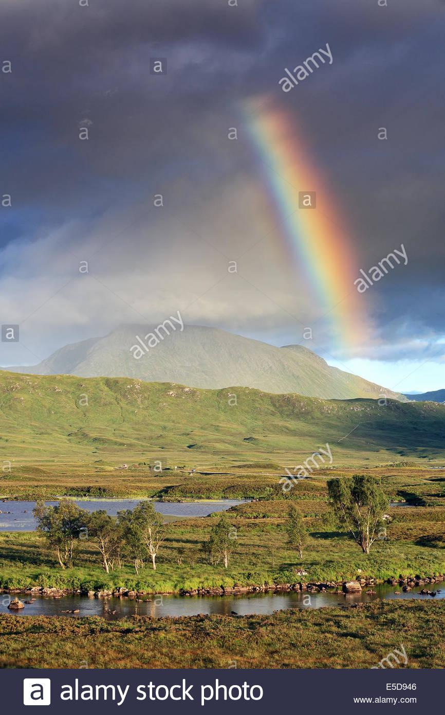 An evening rainbow over Rannoch Moor at Loch Ba - Stock Image