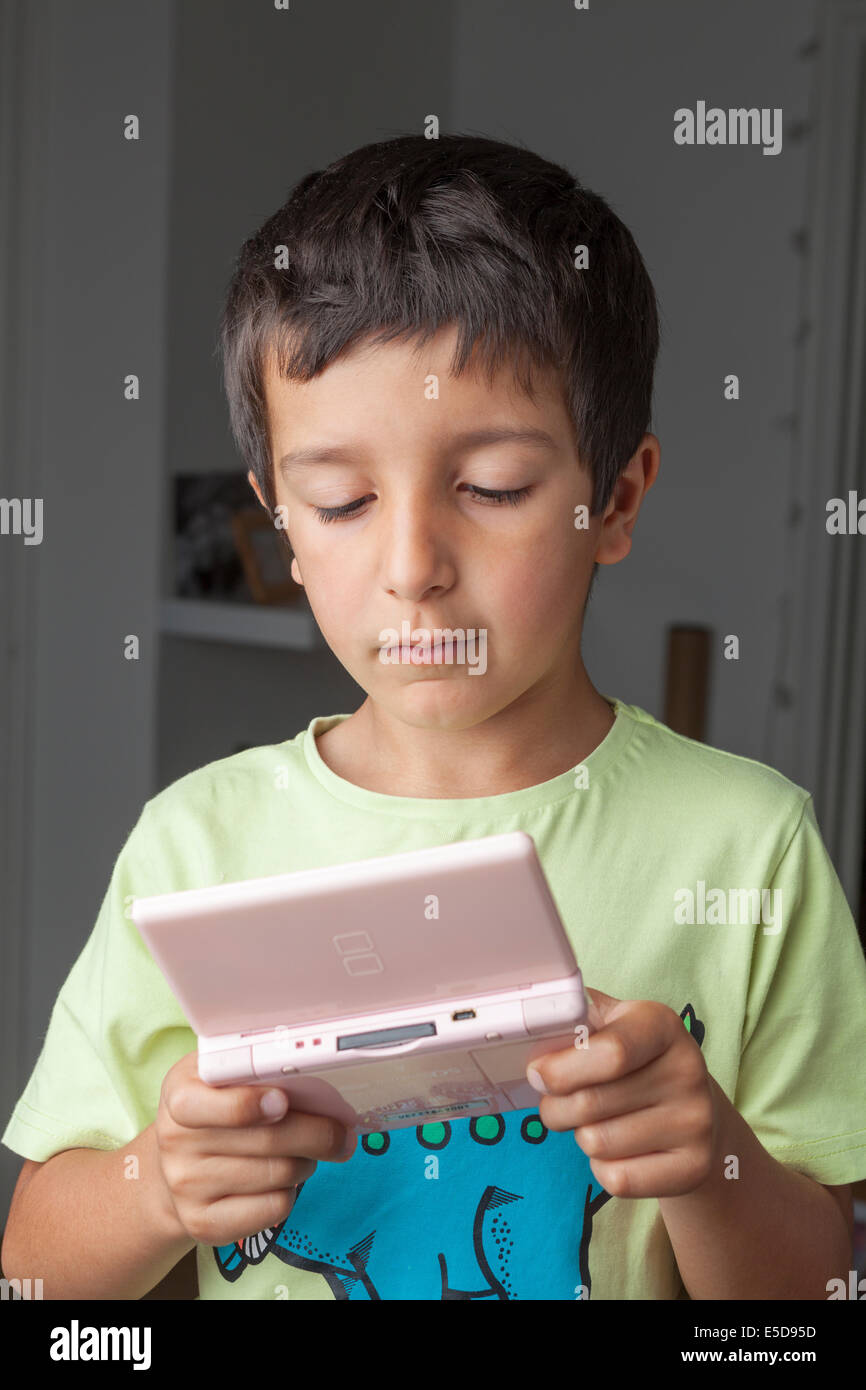 Young boy plays computer game - Stock Image