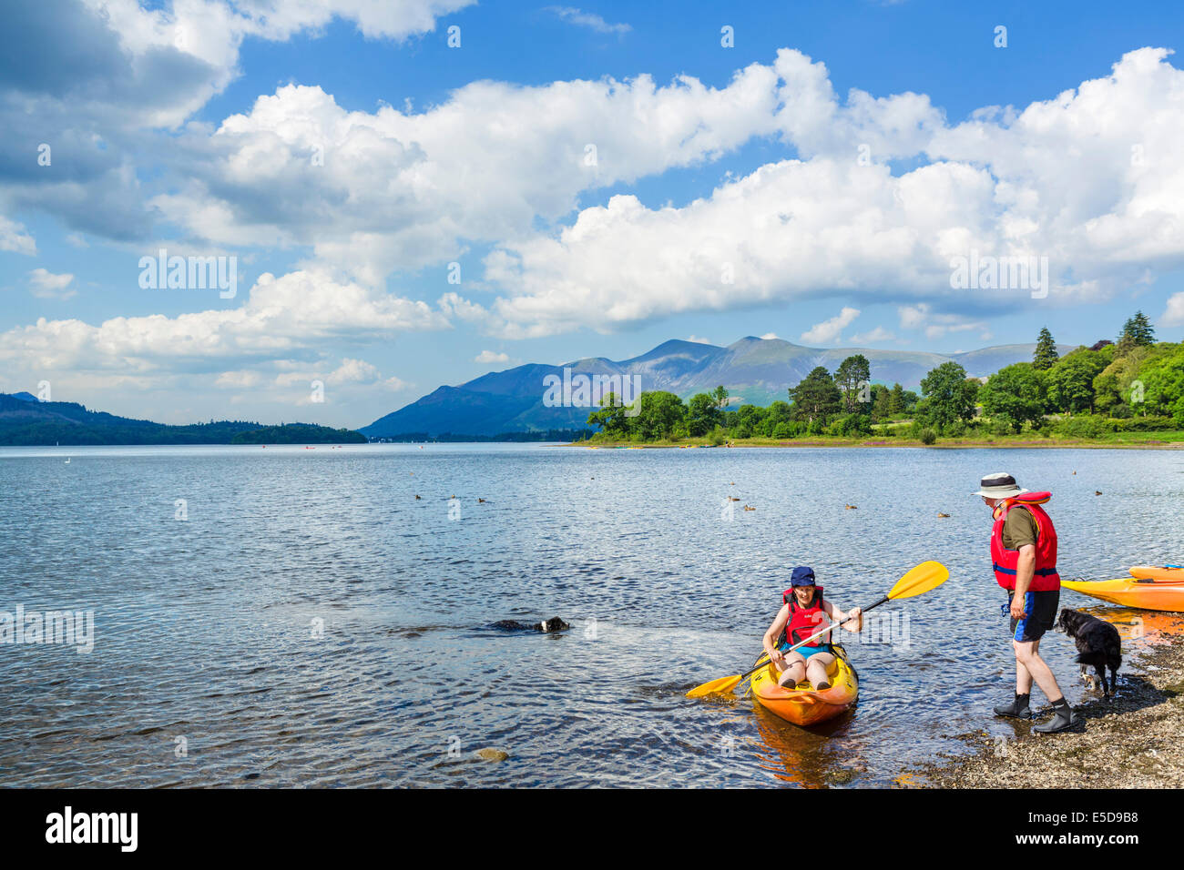 Kayaking on Derwentwater with the Skiddaw massif in the distance, Borrowdale, Lake District, Cumbria, UK - Stock Image