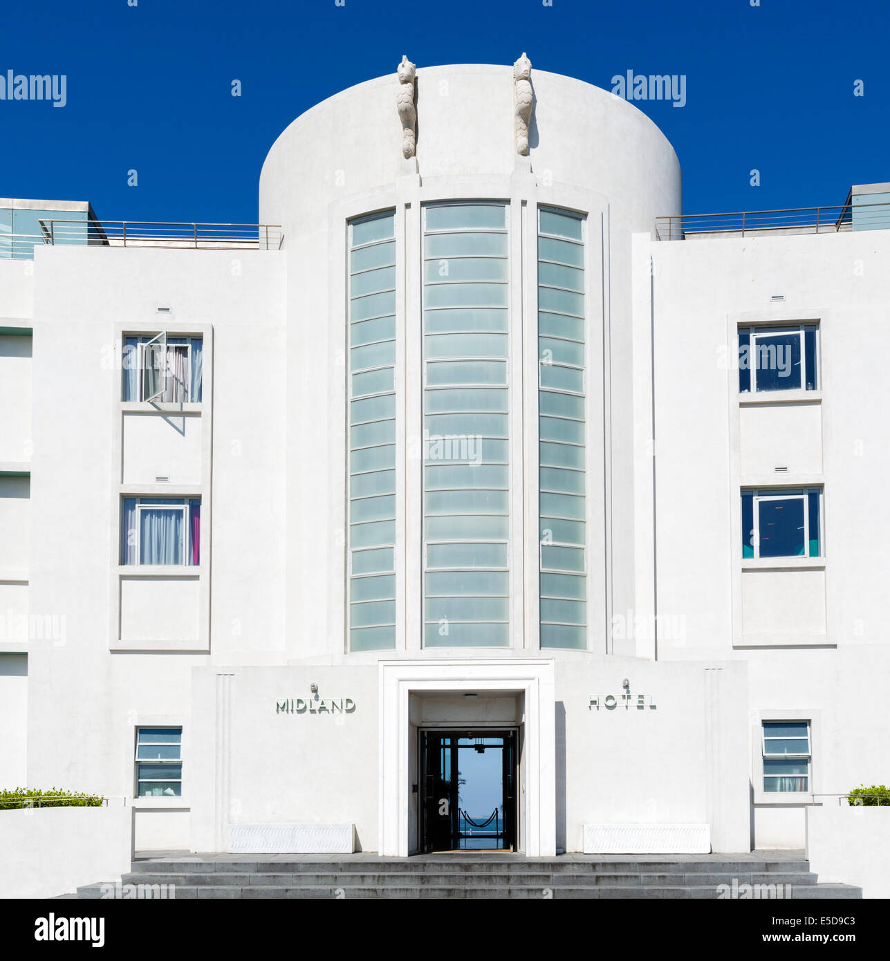 Entrance to the Art Deco Midland Hotel on the promenade in the seaside resort of Morecambe, Lancashire, UK - Stock Image
