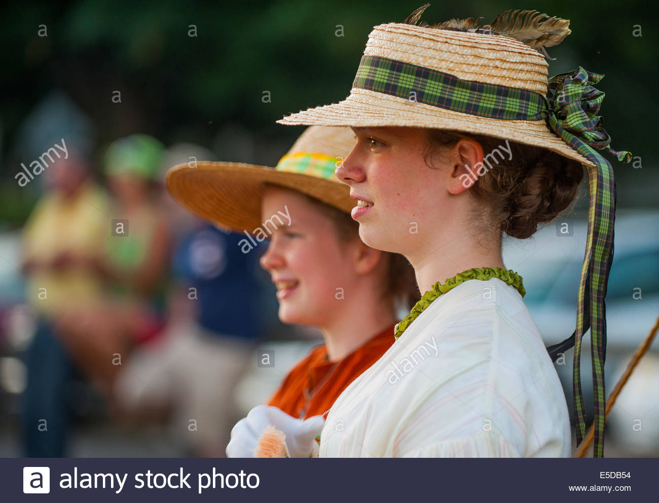 Vancouver, Washington, US. 26th July, 2014. Young girls ''of the 1860's'' watch the reenactment - Stock Image