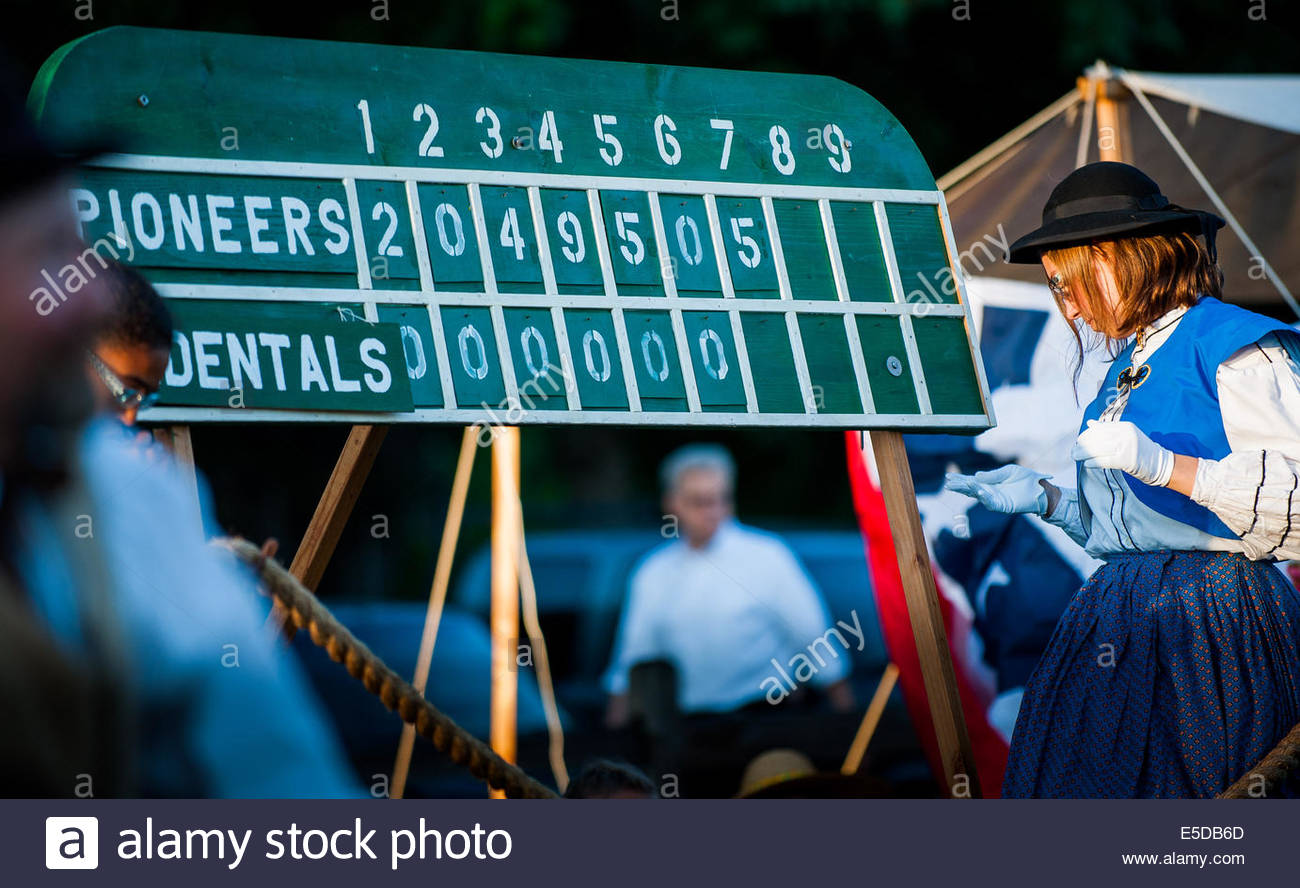 Vancouver, Washington, US. 26th July, 2014. Young girls of the 1860's would tend the score board. On May 29, - Stock Image