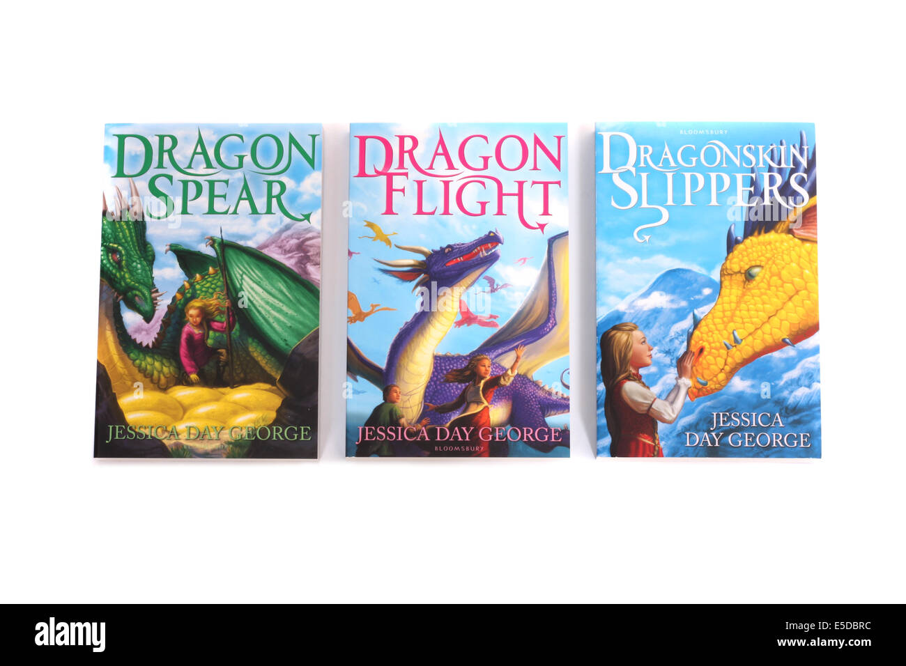 Three books by Jessica Day George, Dragon Spear, Dragon Flight and Dragonskin Slippers. - Stock Image